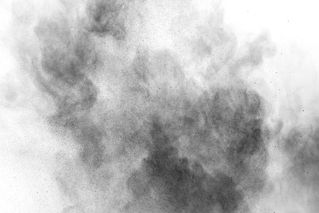 black cloud of dust on a white background