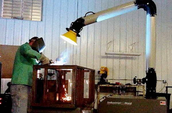 Industrial Maid PFC12 Portable Fume collector in use in a welding shop