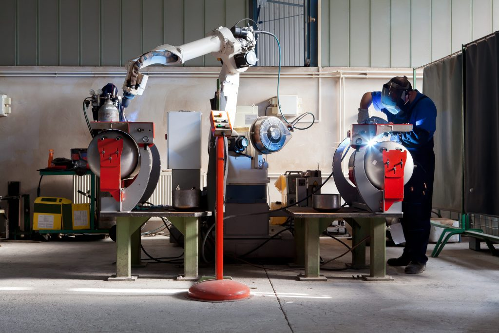 Robotic and Automated Welding Tools in a Machine shop to demonstrate the need for welding air filtration solution.